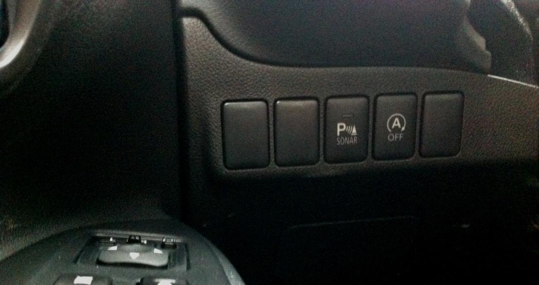 Två knappar i Mitsubishi Outlander